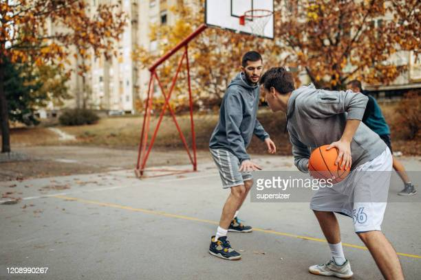 two friends play basketball - amateur stock pictures, royalty-free photos & images