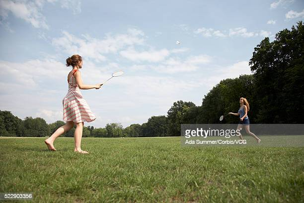 Two friends playing badminton