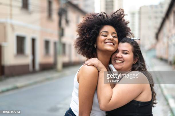 two friends portrait - alternative lifestyle stock pictures, royalty-free photos & images