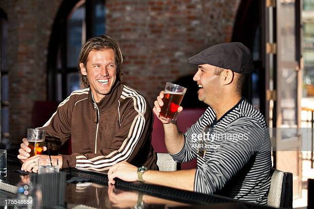 Two friends relaxing at a bar