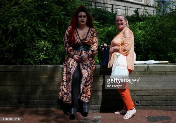 Two friends rest on a wall as they take part in the Newcastle Pride Festival parade on July 20, 2019 in Newcastle upon Tyne, England. To commemorate...