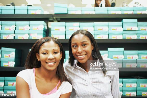 Two friends shopping for shoes