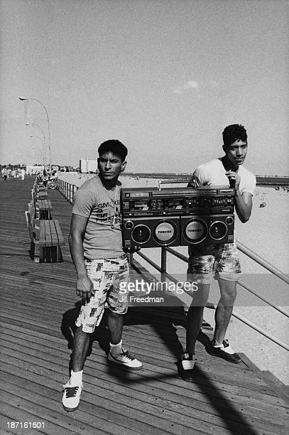 Two friends show their portable stereo on the beach at Coney Island New York City 1986