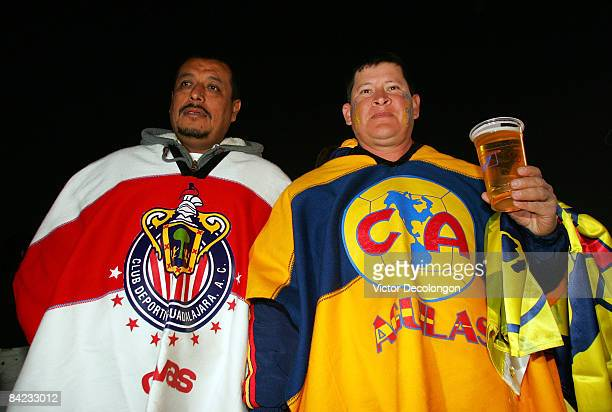Two friends show their support of their teams as they attend the two InterLiga matches of Atlas v Club America and CD Chivas de Guadalajara v UANL...