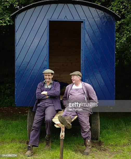 Two friends sit outside their old wooden trailer at the annual Duncombe Park Steam Fair on July 3 2016 in Helmsley England Held in the picturesque...