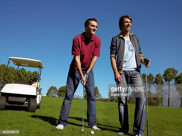 two friends standing together on a golf course - amateur stock pictures, royalty-free photos & images