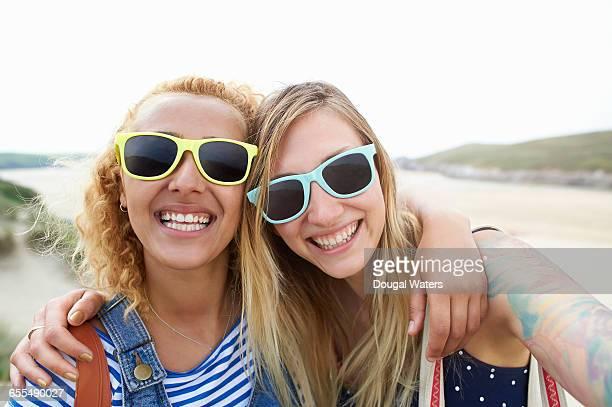 Two friends take a self portrait at beach.