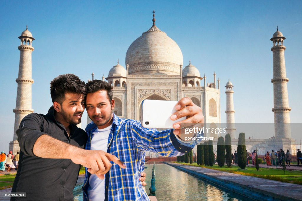 Two Friends taking a Selfie at the Taj Mahal in Agra, India : Stock Photo