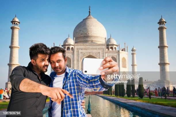 Two Friends taking a Selfie at the Taj Mahal in Agra, India