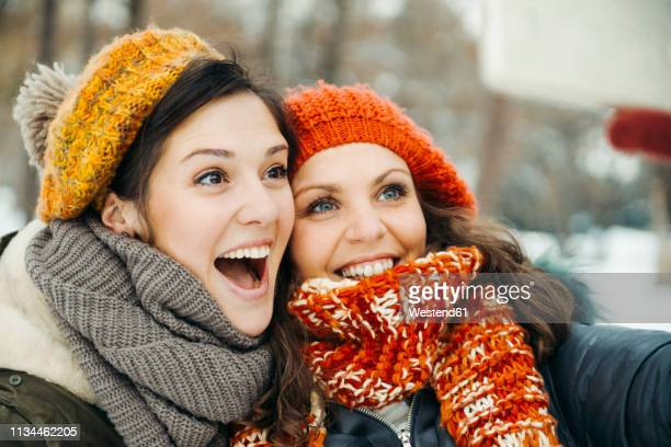 two friends taking selfies in the snow - girlfriend stock pictures, royalty-free photos & images