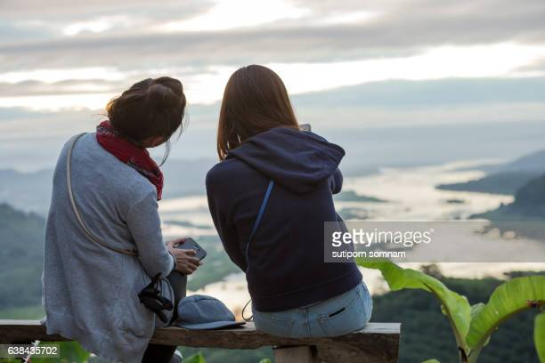 Two friends together to watch the sunrise.