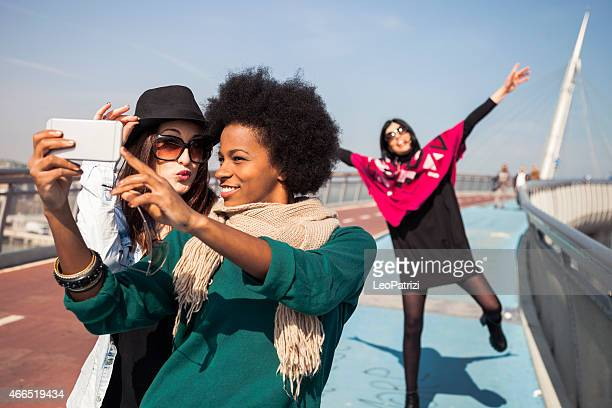"Two friends victim of ""photo bombing"" taking a selfie"
