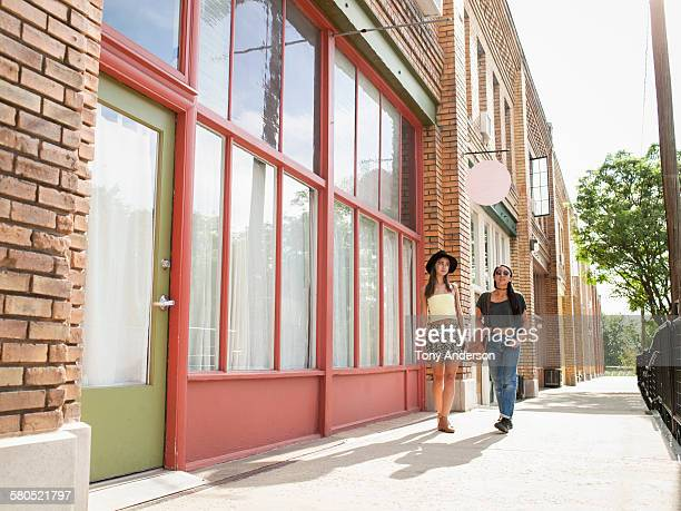 two friends walking in city shopping area - salt lake city stock pictures, royalty-free photos & images