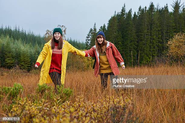Two friends walking in nature