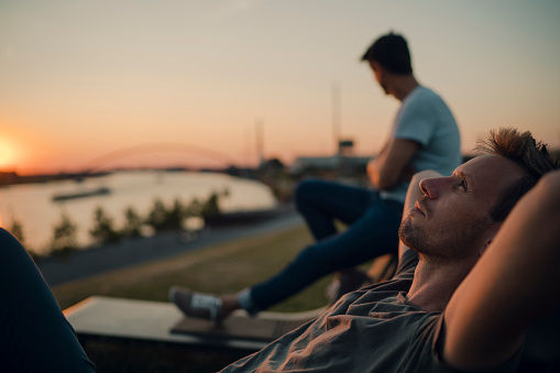 Two friends watching sunset at the river - gettyimageskorea