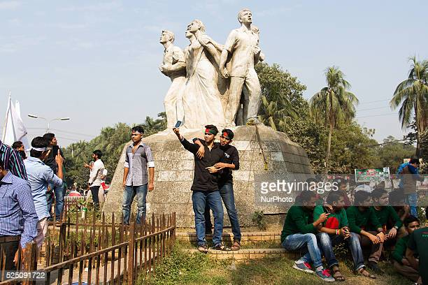 Two friends were taking their selfie standing in front of a monument in front of TSC Dhaka University