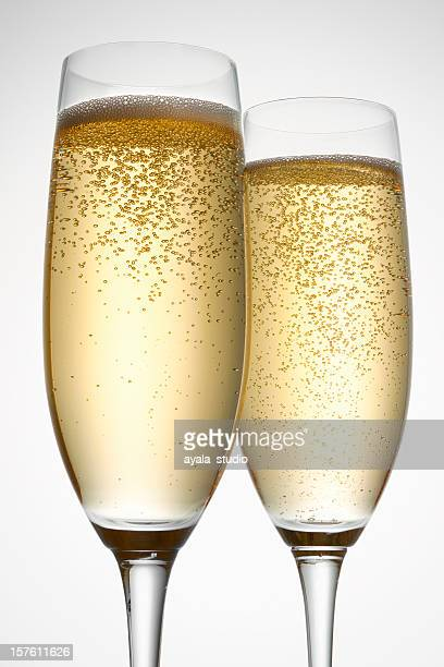 Two full champagne flutes