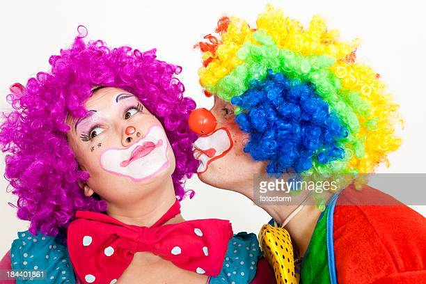 Two Funny Clowns Kissing