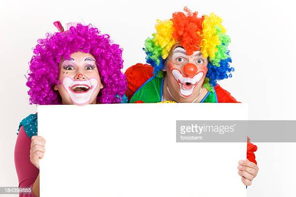 Two Funny Clowns With Blank Banner