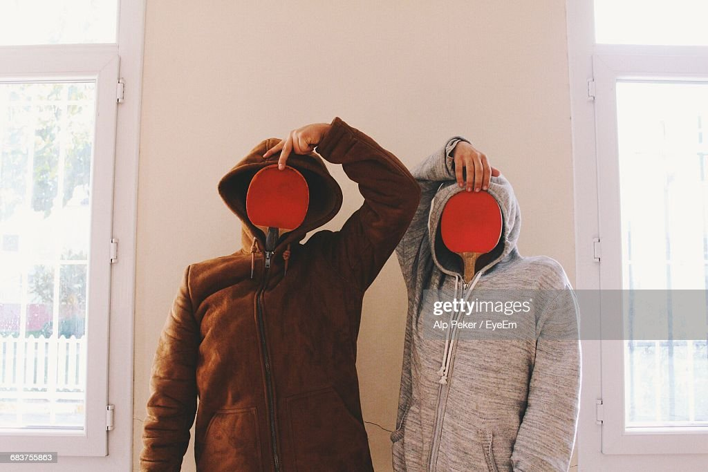 Two Funny People With Obscured Faces : Stock Photo