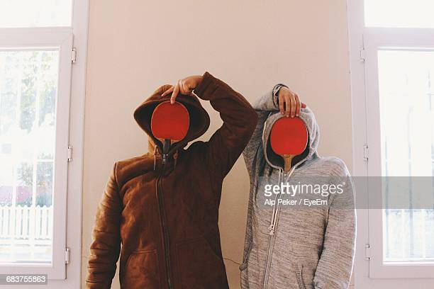 two funny people with obscured faces - funny ping pong stock pictures, royalty-free photos & images