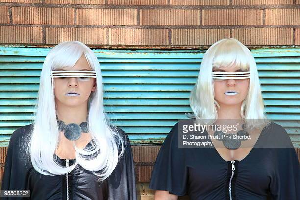Two Futuristic Space Age Girls Against Vent Cover