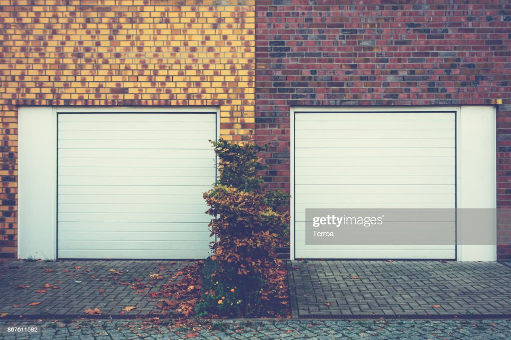 Two Garage Doors In Townhouses Stock Photo Getty Images