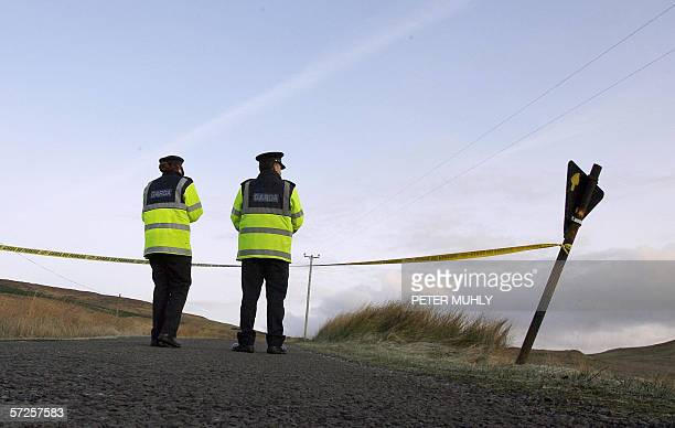 Two Gardi officers place tape along a road leading to the remote house in Donegal Ireland of Denis Donaldson 05 April 2006 Donaldson a former British...