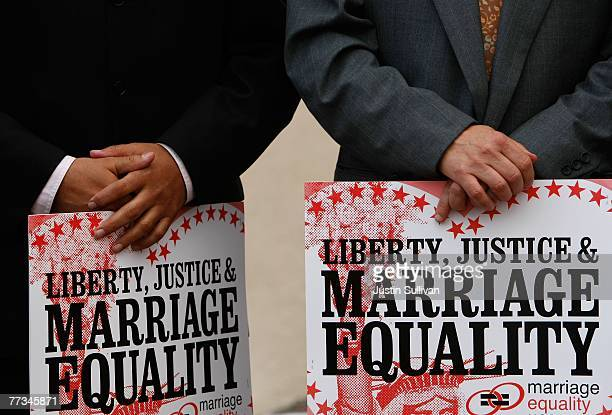 Two gay men hold signs during a same sex marriage demonstration October 15 2007 in San Francisco California About a dozen samesex couples held a...