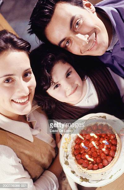 two generation family celebrating birthday of daughter (6-7 years), elevated view - 25 29 years stock pictures, royalty-free photos & images