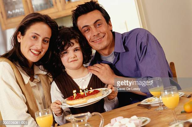 two generation family celebrating birthday of daughter (6-7 years) - 25 29 years stock pictures, royalty-free photos & images