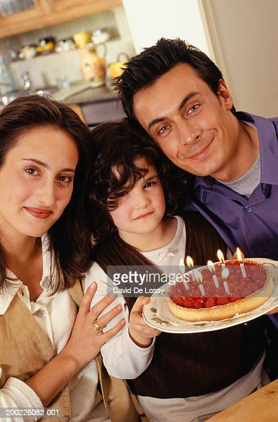 Two generation family celebrating birthday of daughter (6-7 years)