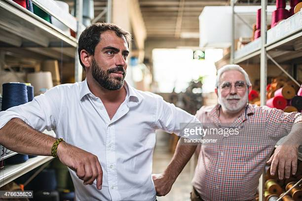 two generations industrial owner inside their factory - two generation family stock pictures, royalty-free photos & images