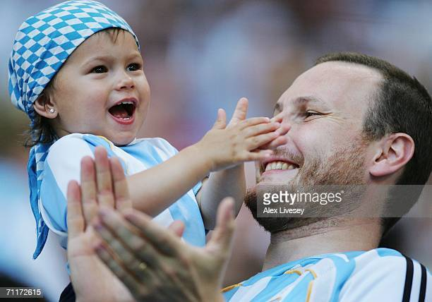 Two generations of Argentina fans soak up the atmosphere prior to the FIFA World Cup Germany 2006 Group C match between Argentina and Ivory Coast...