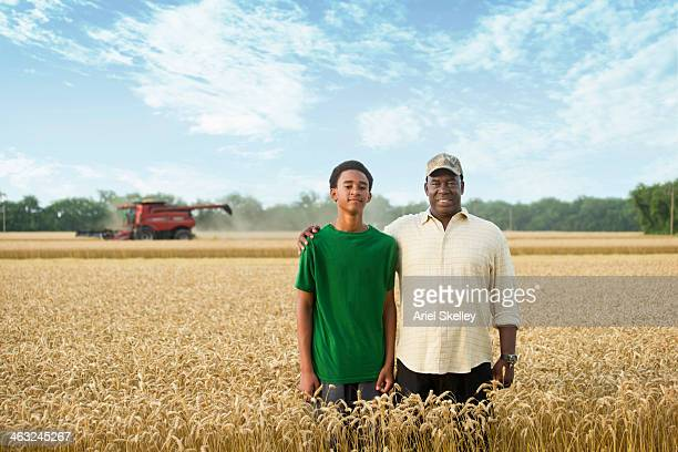 Two generations of Black farmers in wheat field