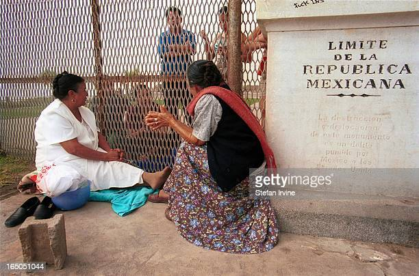 CONTENT] Two generations of family members meet for a picnic through the USMexico border fence just outside Tijuana