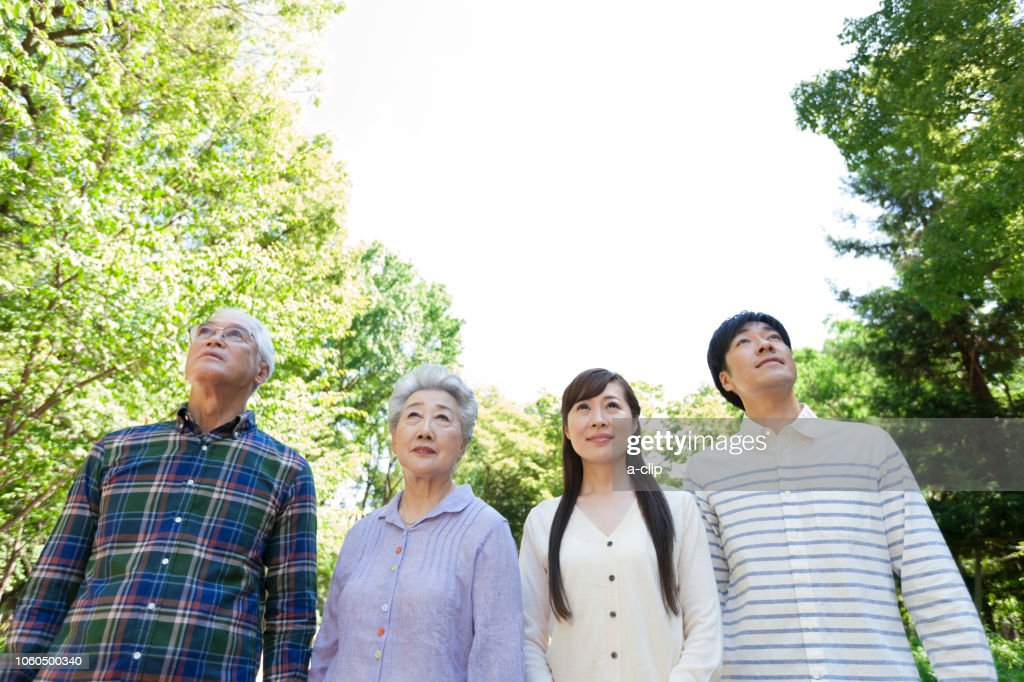 Two generations of smiling families : Stock Photo