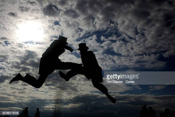 'Two gentleman jump in front of the grandstand as they pose for pictures after the race meeting at Royal Ascot Race Course Royal Ascot is one of the...