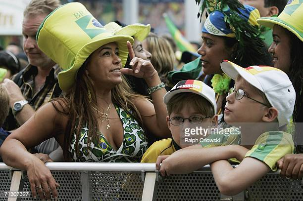 Two German boys stand next to Brazilian football supporters during a live-broadcast of the Round of 16 Brazil v Ghana matchon June 27, 2006 in...