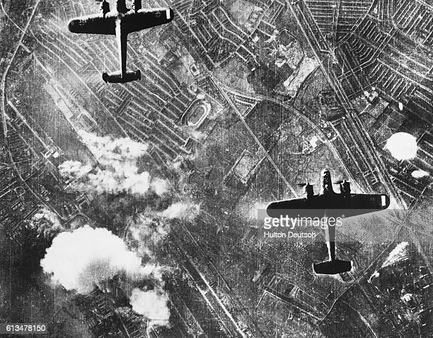 Two German Dornier 217 aircraft on the offensive over the Silvertown area of London's Dockland in the autumn of 1940 Below smoke billows into the air...