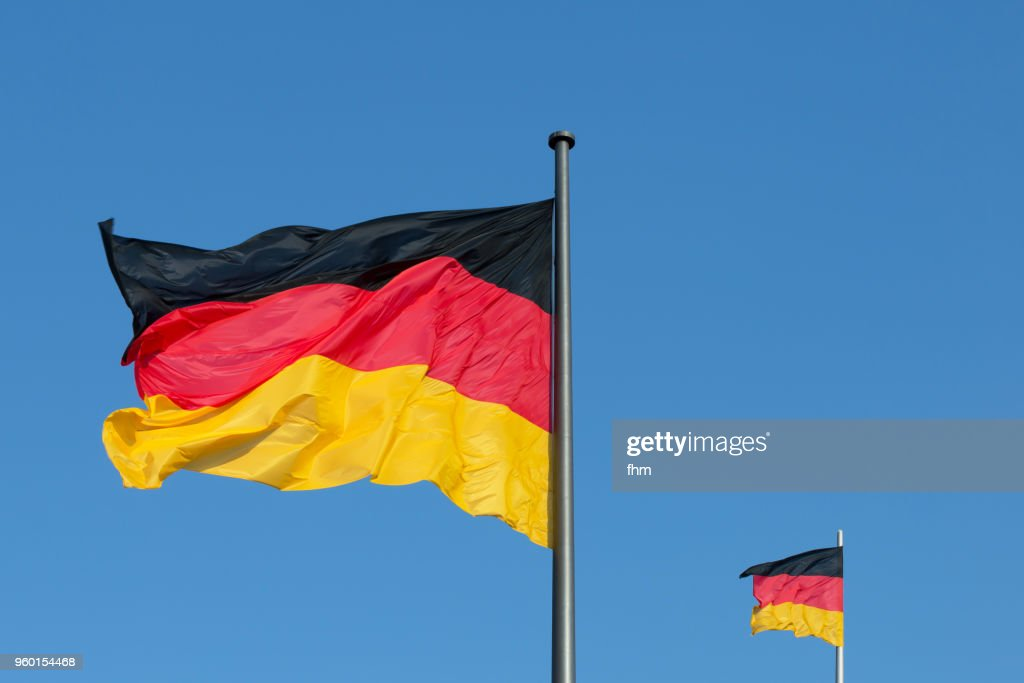 Two German flags with blue sky (Berlin, Germany) : Stock Photo