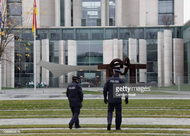 Two german policemen walk in front of the chancellery during the visit of the dutch primeminister Mark Rutte on November 19 2010 in Berlin Germany...