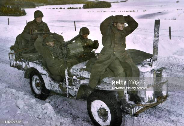 Two German Prisoners Being Brought in ArdennesAlsace Campaign Battle of the Bulge 1945