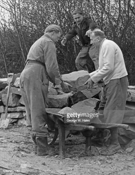 Two German prisoners-of-war help Canon CC Griffiths , the Rural Dean of Hastings, to rebuild the parish church of St Leonards which was destroyed...