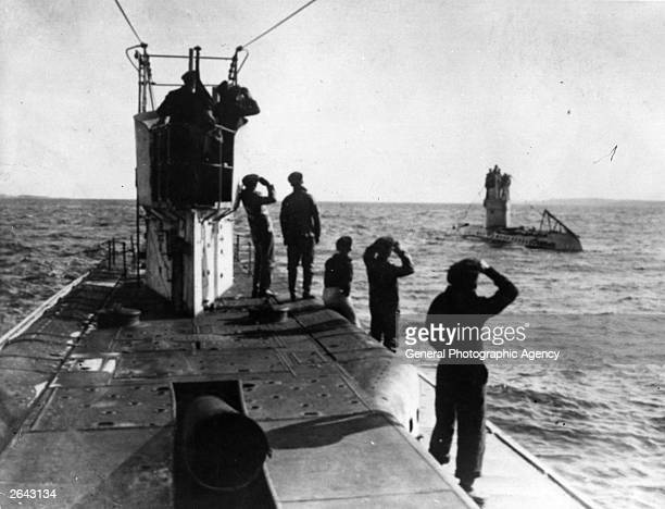 Two German submarines the U35 and U42 surface off the Mediterranean coast