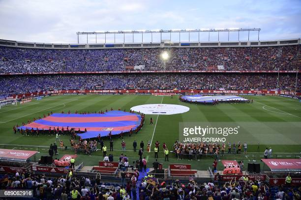 Two giant jerseys of both teams are displayed on the pitch before the Spanish Copa del Rey final football match FC Barcelona vs Deportivo Alaves at...