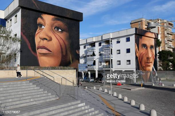 Two giant murals by the street artist Jorit Agoch depicting Angela Davis on the left and Pier Paolo Pasolini on the right in the Scampia district of...