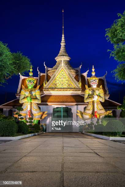 two giant or gaurdian at the door of wat Arun temple at night after sunset time in Bangkok Thailand