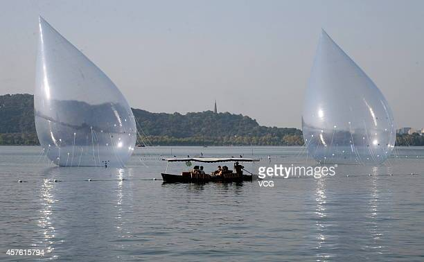 Two giant water dropshaped airfilled models are placed on West Lake on October 19 2014 in Hangzhou China A performing art exhibition of 'Dancing...
