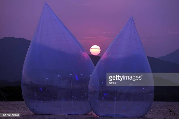 Two giant water dropshaped airfilled models are placed on West Lake on October 18 2014 in Hangzhou China A performing art exhibition of 'Dancing...